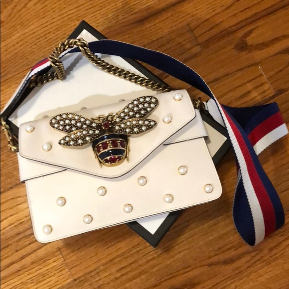 3ce50d71536 Gucci Handbags - Authentic Gucci off white leather bee bag.